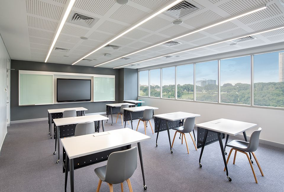 Empty hospitality management classroom with desks and a smart blackboard