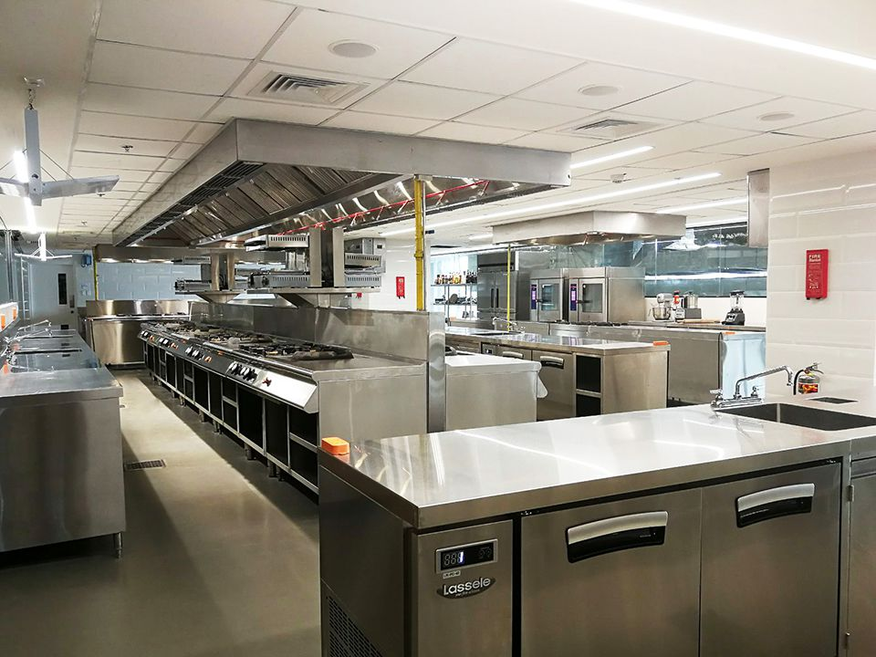 Other side of fully equipped Careme kitchen for culinary students